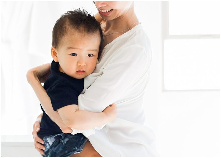 Chinese Boy Holding Mom